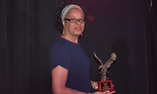 Black Heritage one of the lady award winners holding trophy