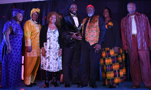 Black Heritage group of award winners holding trophy