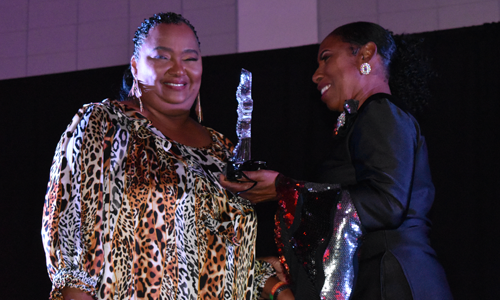 Black Heritage lady receiving her award